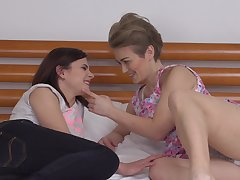Mature lesbians Alana R. together with Alenka lick each others pussies