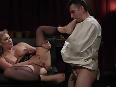 Ryan Keely pegs her male slave and gets her trimmed pussy licked