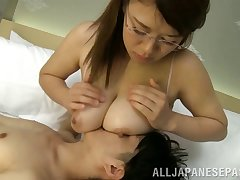 Asian nymph nearby glasses gives a palatable weasel words an outstanding titjob nearby POV