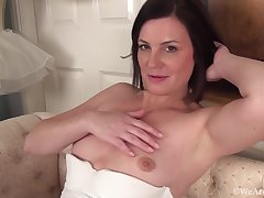 Puristic brunette in white lingerie, stockings plus garter belt is masturbating plus enjoying it a lot