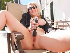 Voice naughty forty Kit moans while playing in outdoors