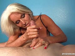 Hot mature pleases man with Victorian handjob and blowjob