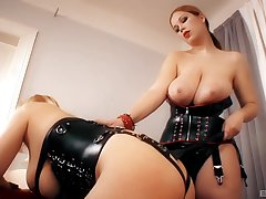 Dominant MILF plays with submissive slut in dirty femdom digs action