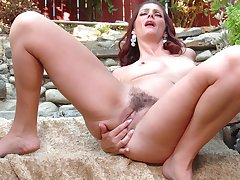 Video of solo redhead Alicia Silver carrying-on with her wet pussy
