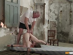 Slim twink endures old man's vulgar chastisement in serious anal BDSM play